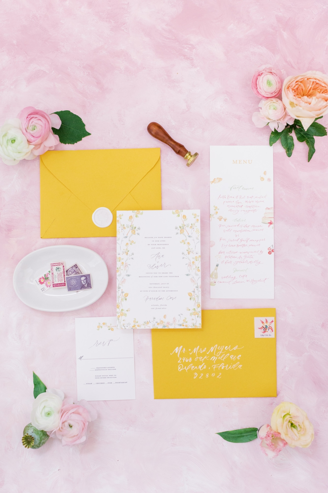 yellow citrus and pink wedding stationary with pink background