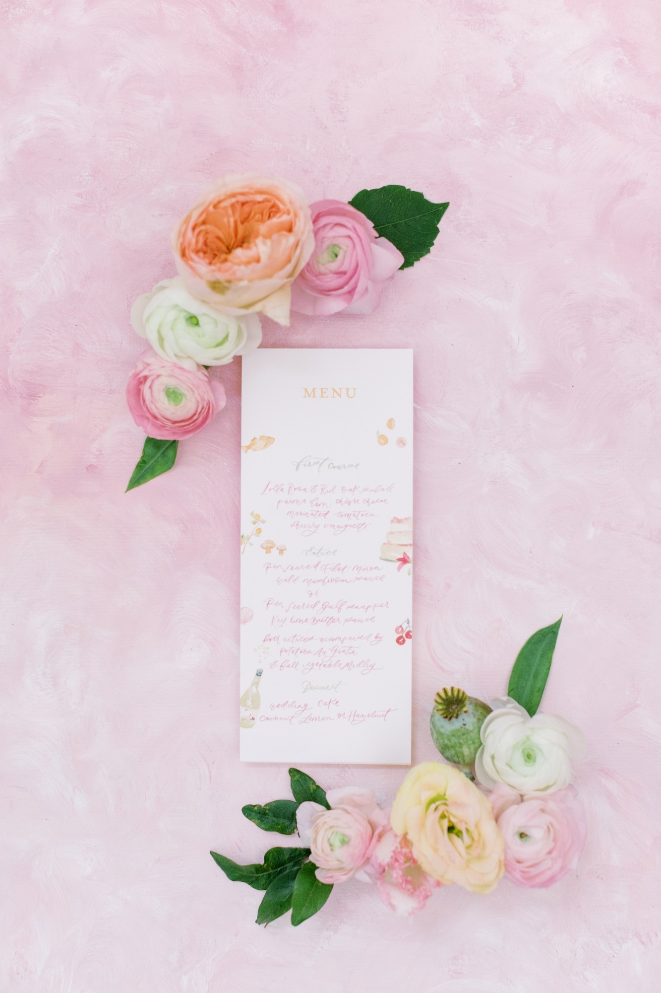 pink script menu for wedding with florals with leaves in pink background