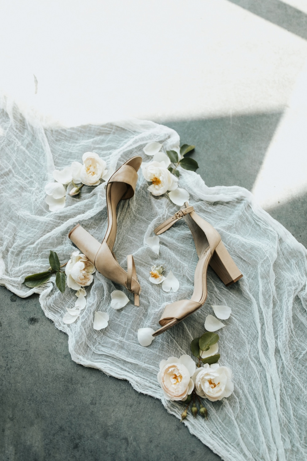 nude bridal heels with florals and rings