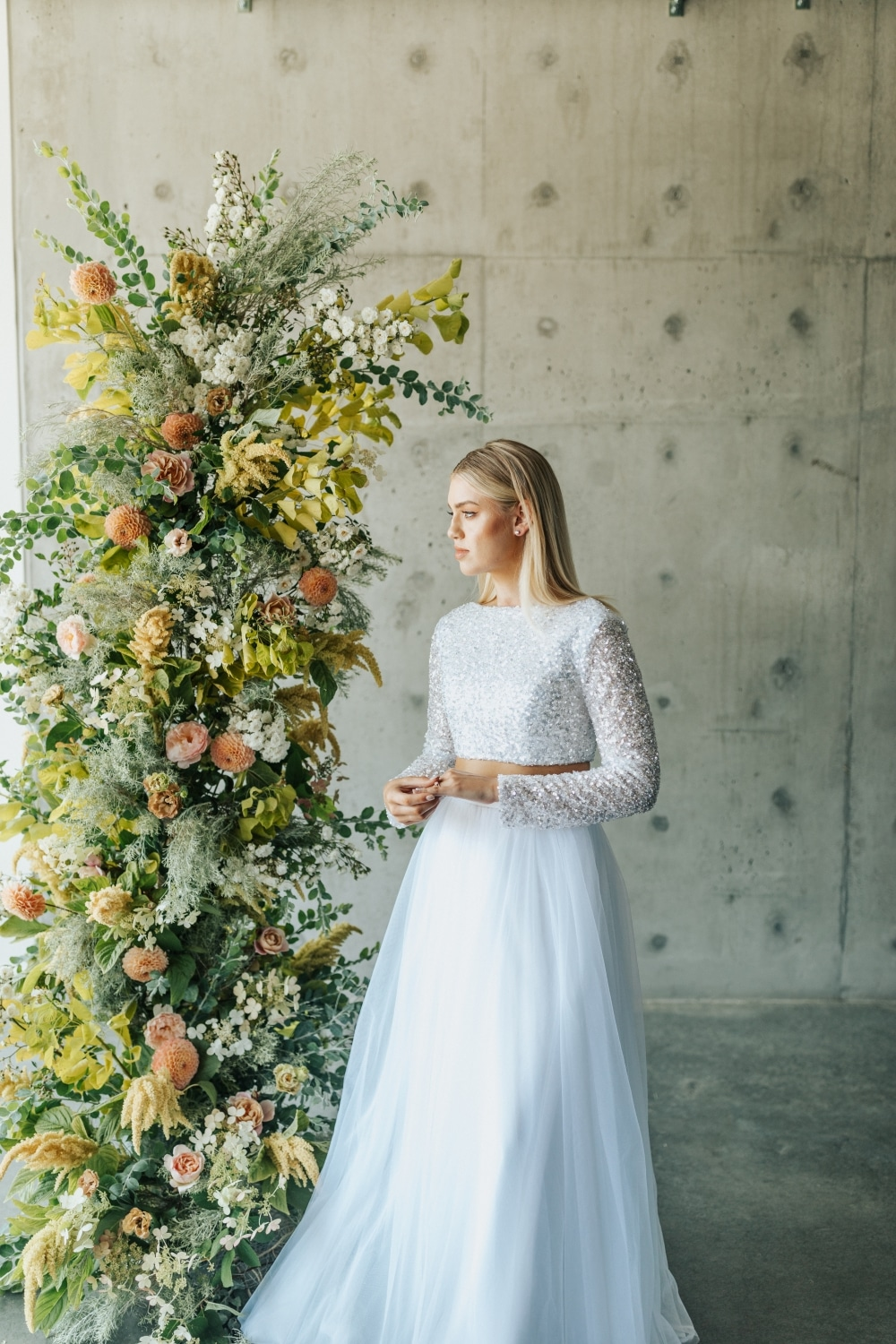 bride in long sleeve wedding gown with florals