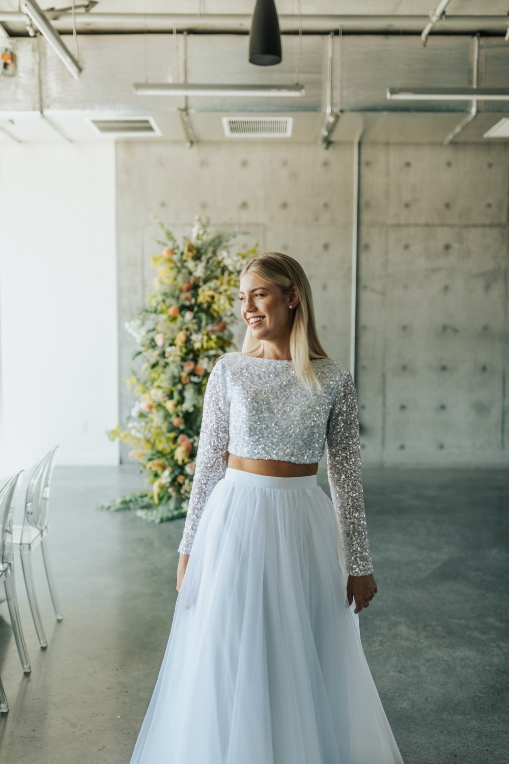 two-piece wedding gown with bedazzled top with rustic background