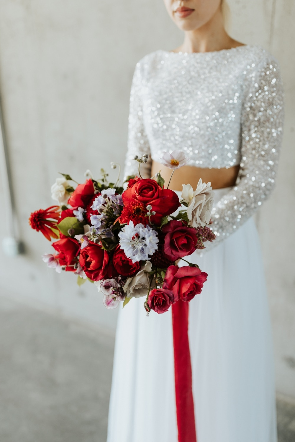 red florals with red ribbon and purple flowers
