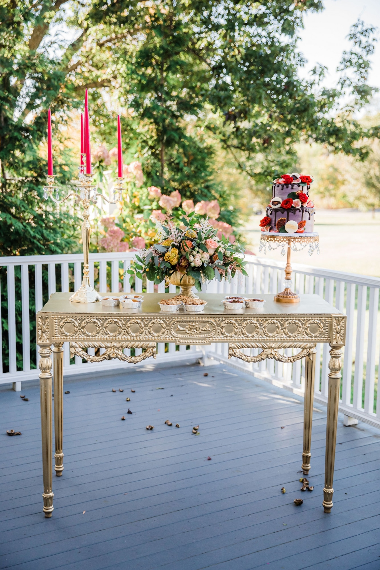 candles and flowers on vintage wooden table painted cream color