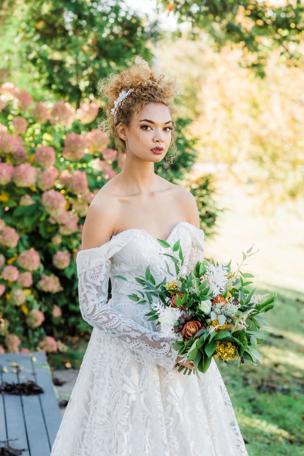 strapless ballgown on stunning bride with fall floral bouquet