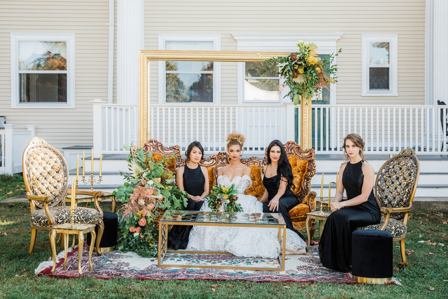 vintage carpet and bright copper colored couch with bride and bridesmaids relaxing with florals all around them