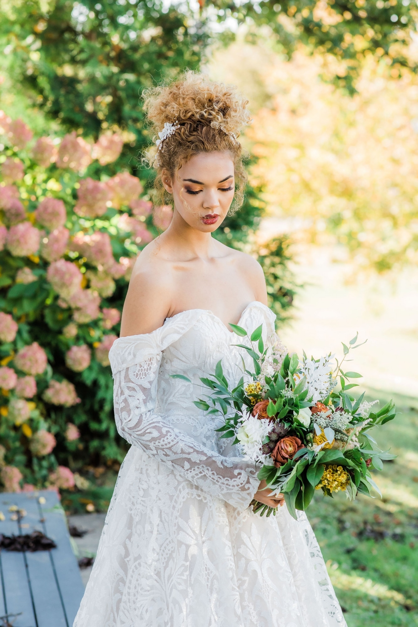 decadent florals with bride in strapless gown looking downwards with stunning makeup