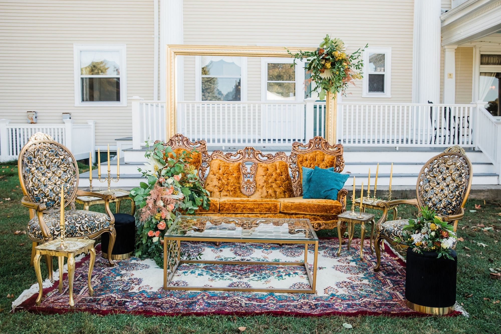 vintage furniture with copper an blue and fall tones with floral all around a seating area
