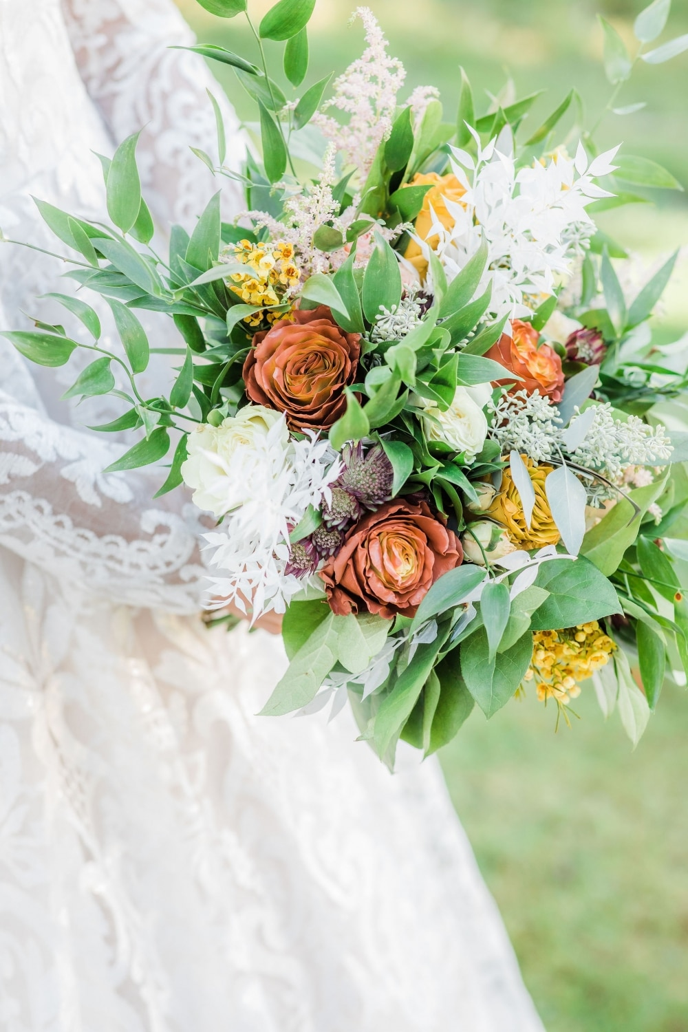 white, yellow, and red bouquet of flowers in fall wedding