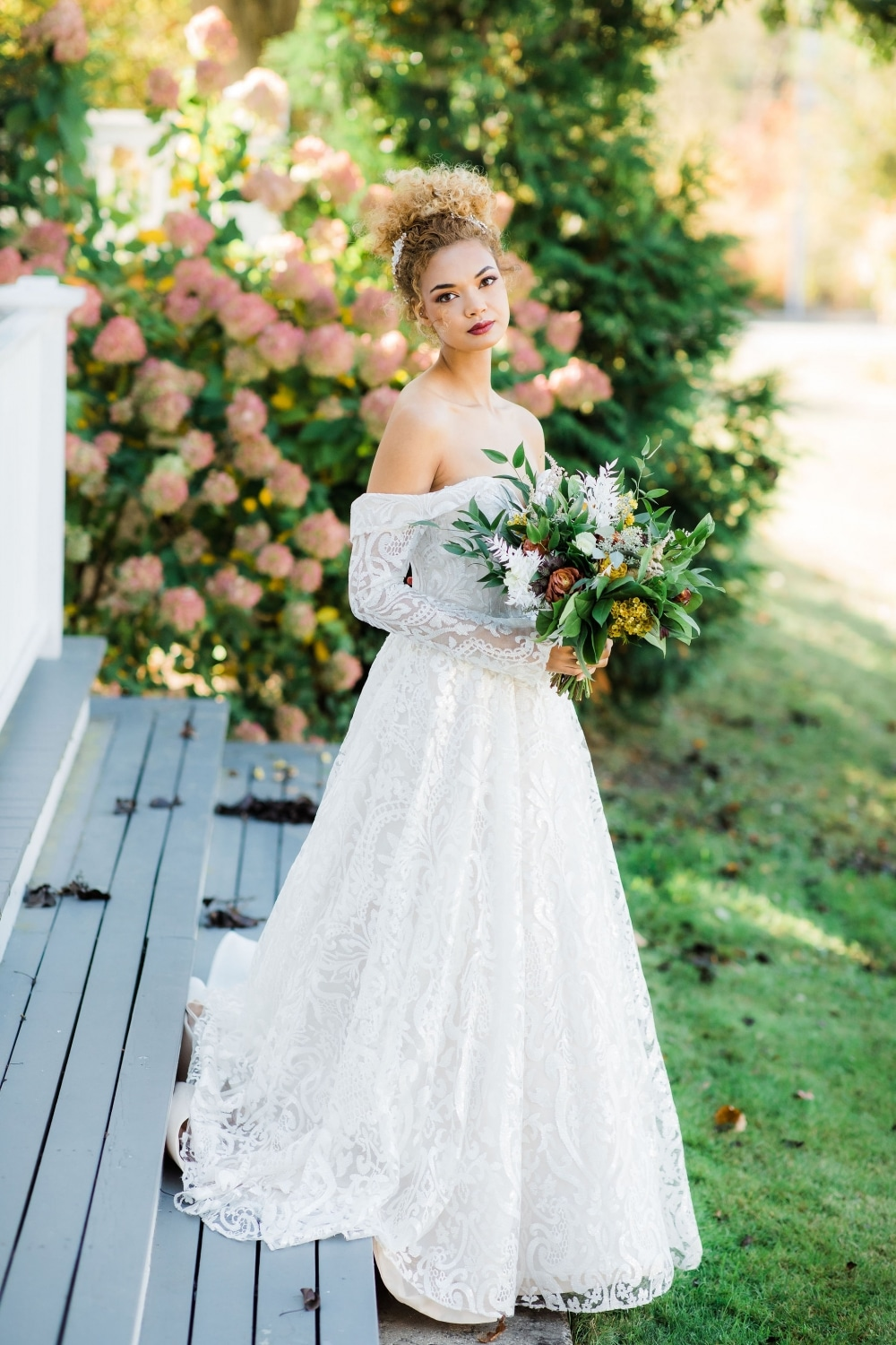 bride at mansion with fall florals