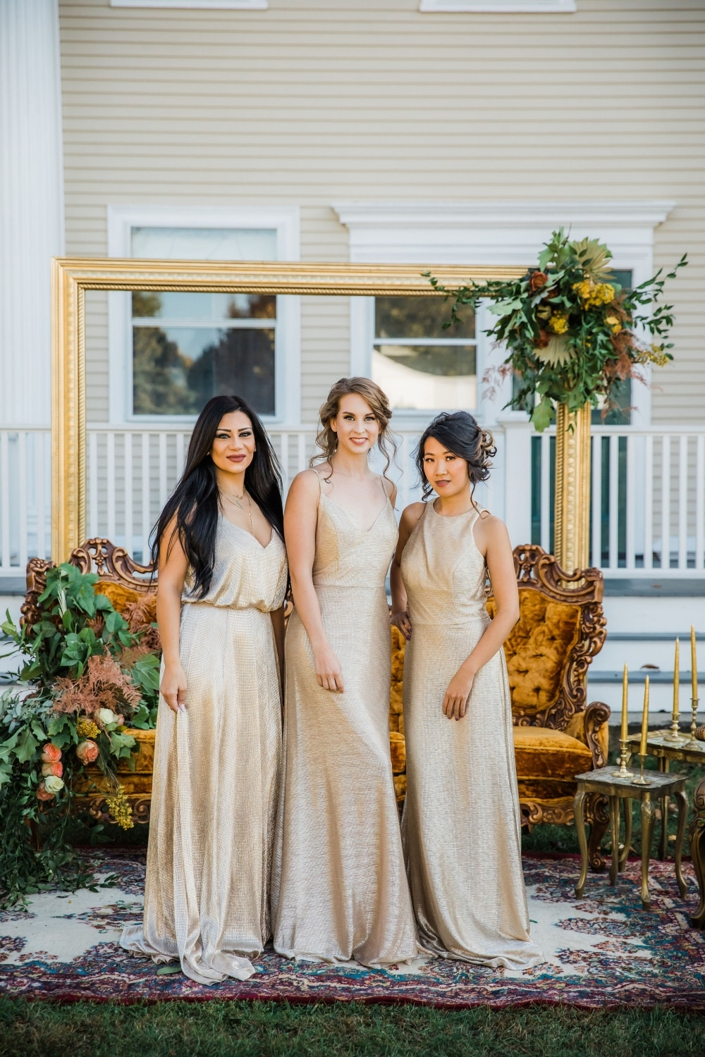 bridesmaids in golden gowns that touch the floor in the vintage seating area setup