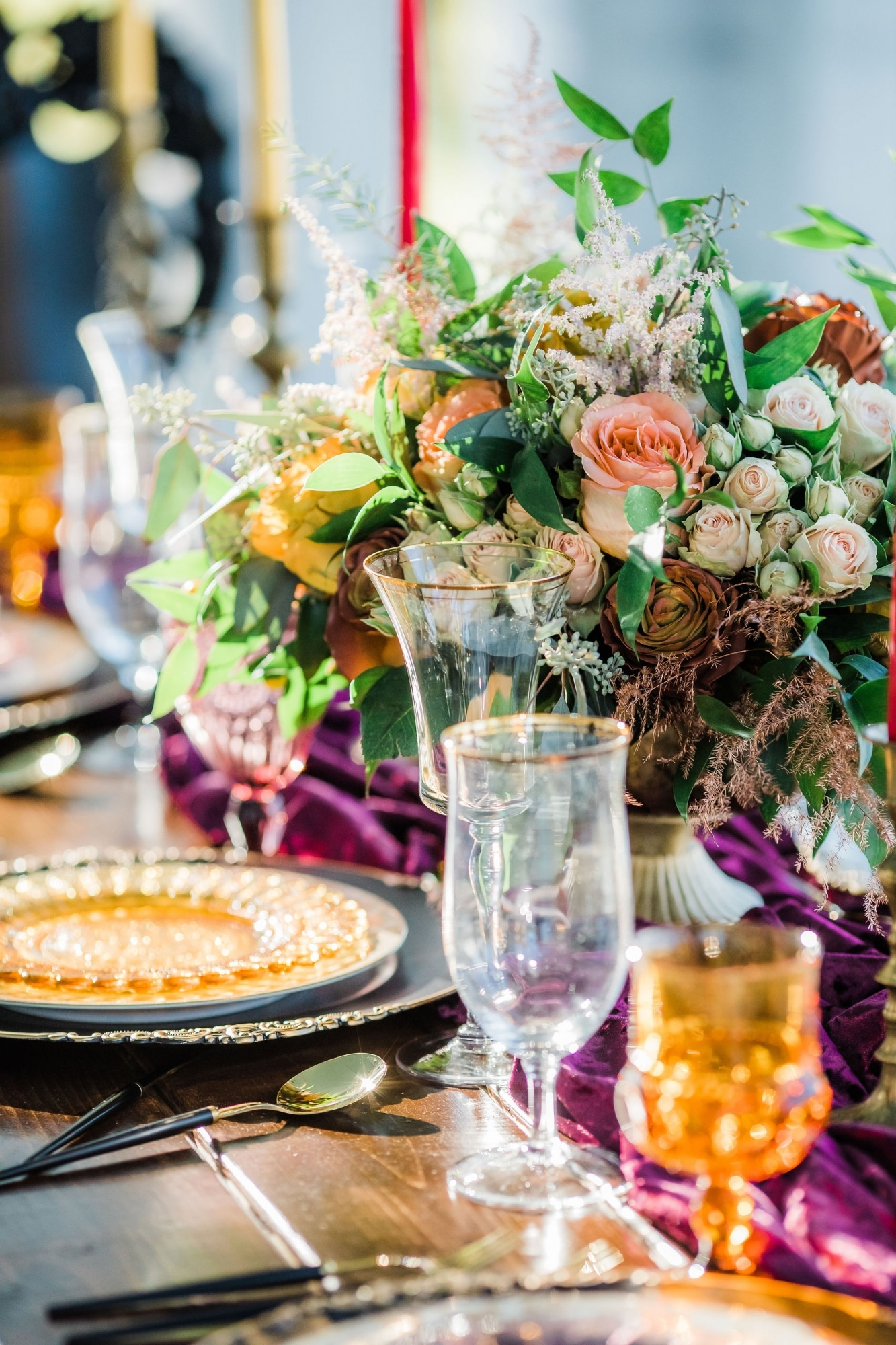 fall florals around purple clear and yellow glassware and table settings