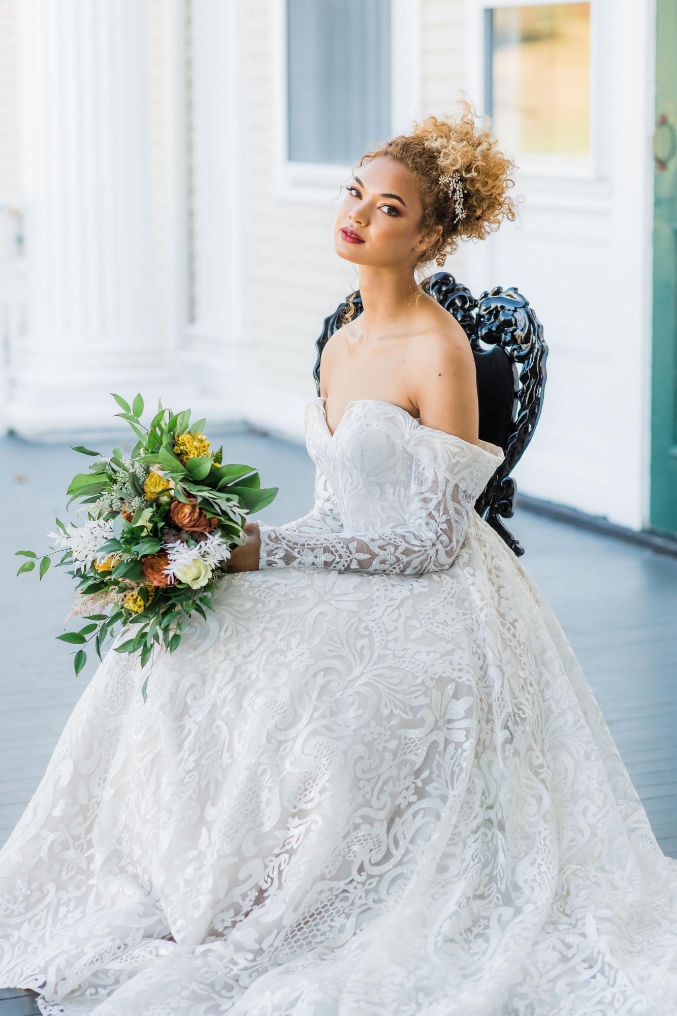 bride sitting strapless ballgown in royal black chair