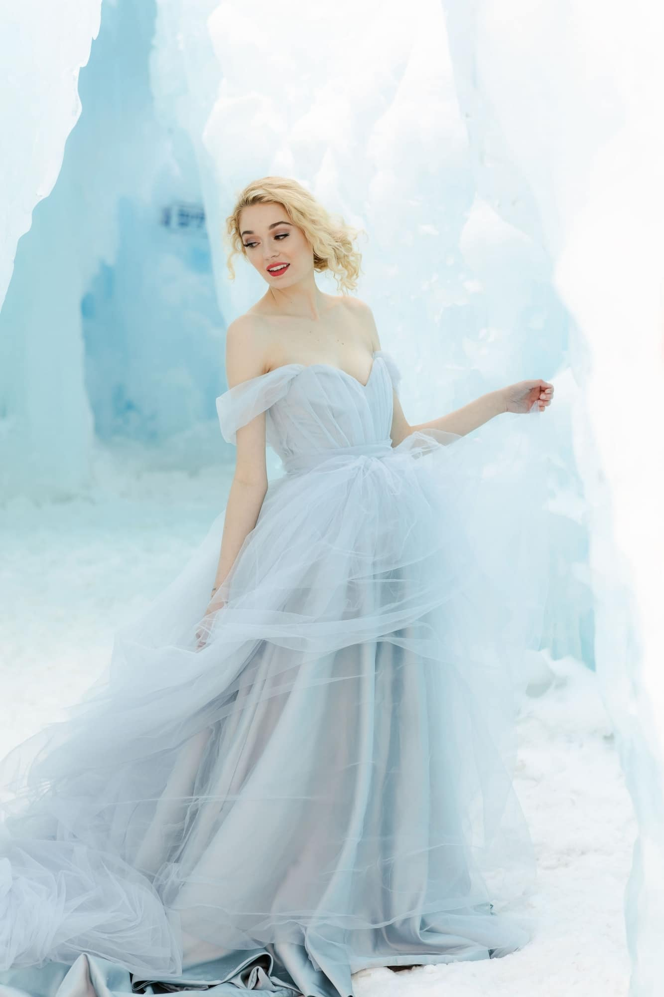 bride with a light blue gown in an ice cave