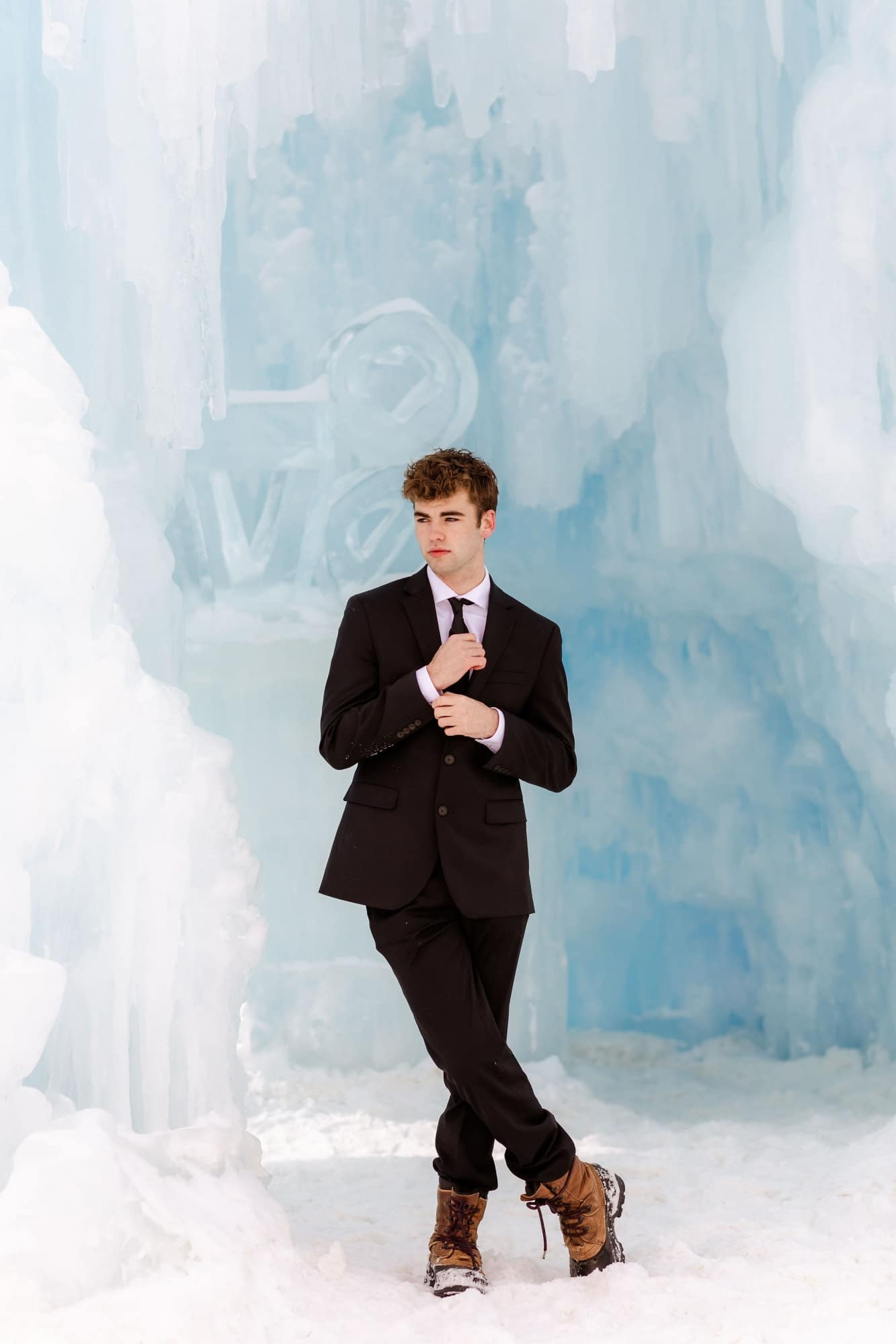 groom standing in an ice cave