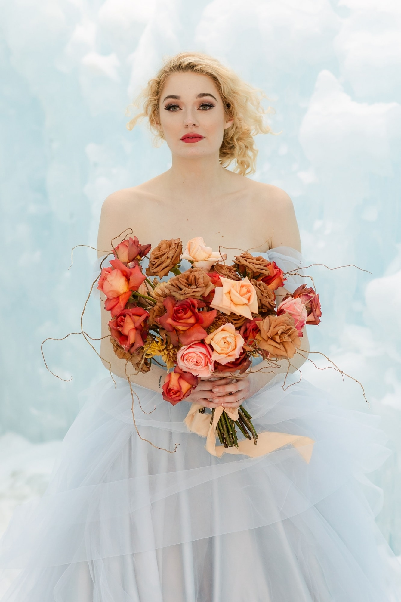 winter bride holding a colorful bouquet
