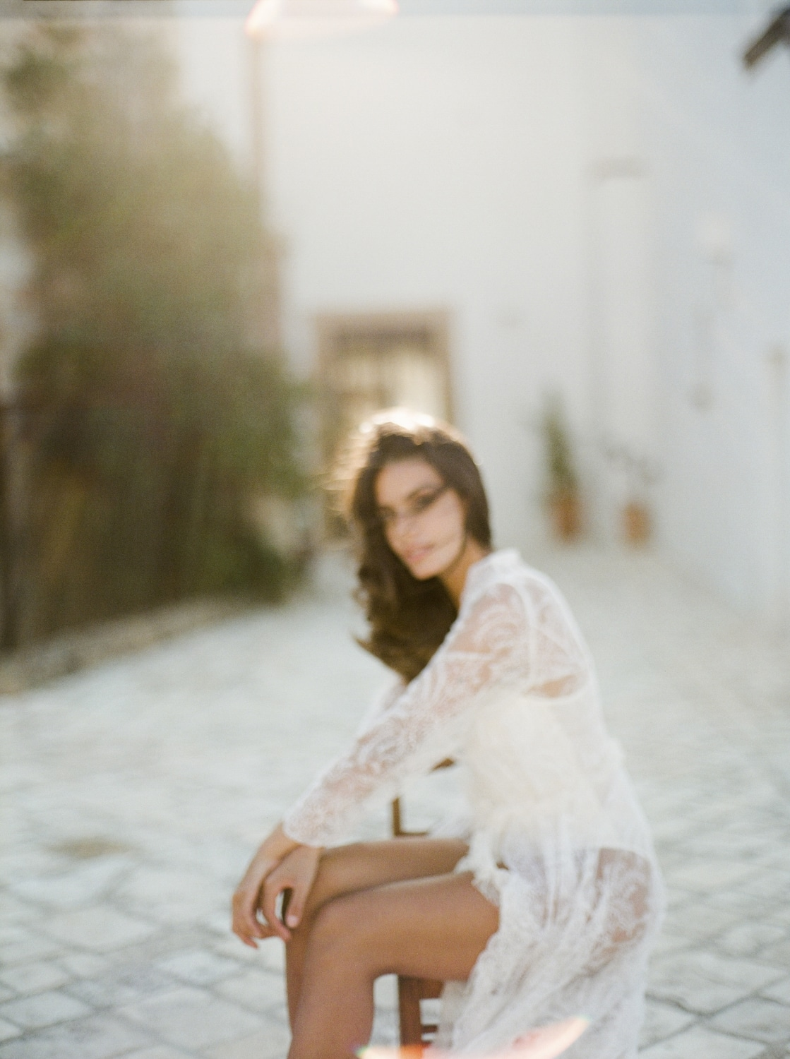 bride sitting in all lace wedding gown in Apulia italy
