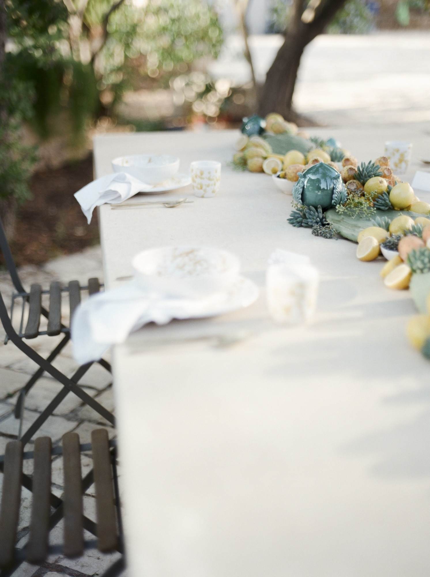 yellow florals with white table setting in wedding in apulia italy