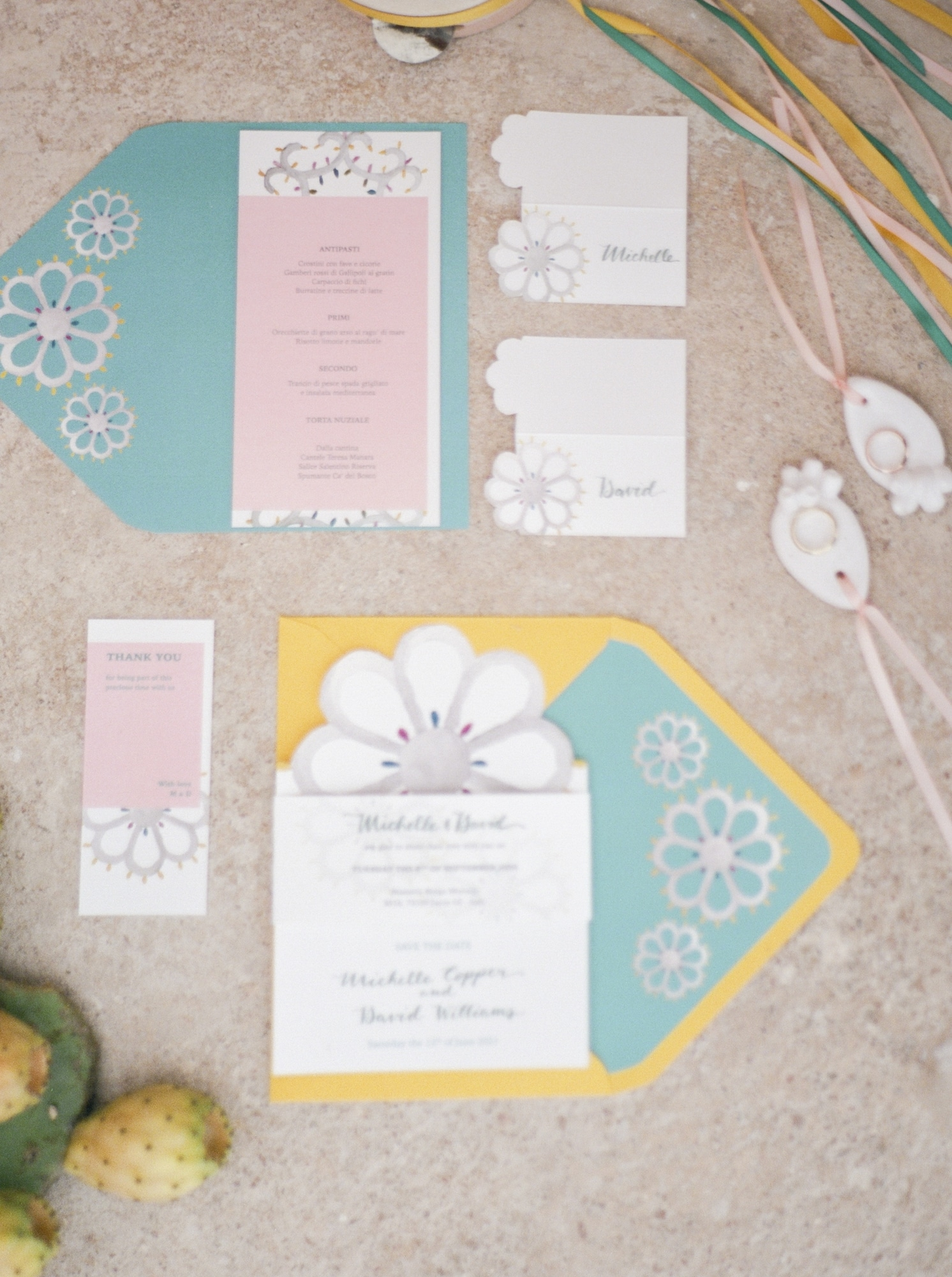 pink blue yellow and white stationery