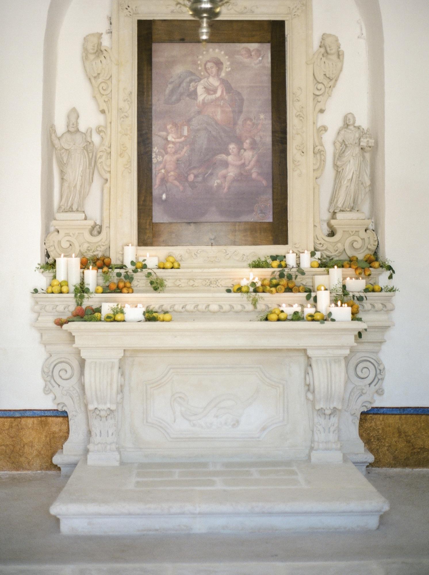 altar in church in Apulia italy with florals and candles