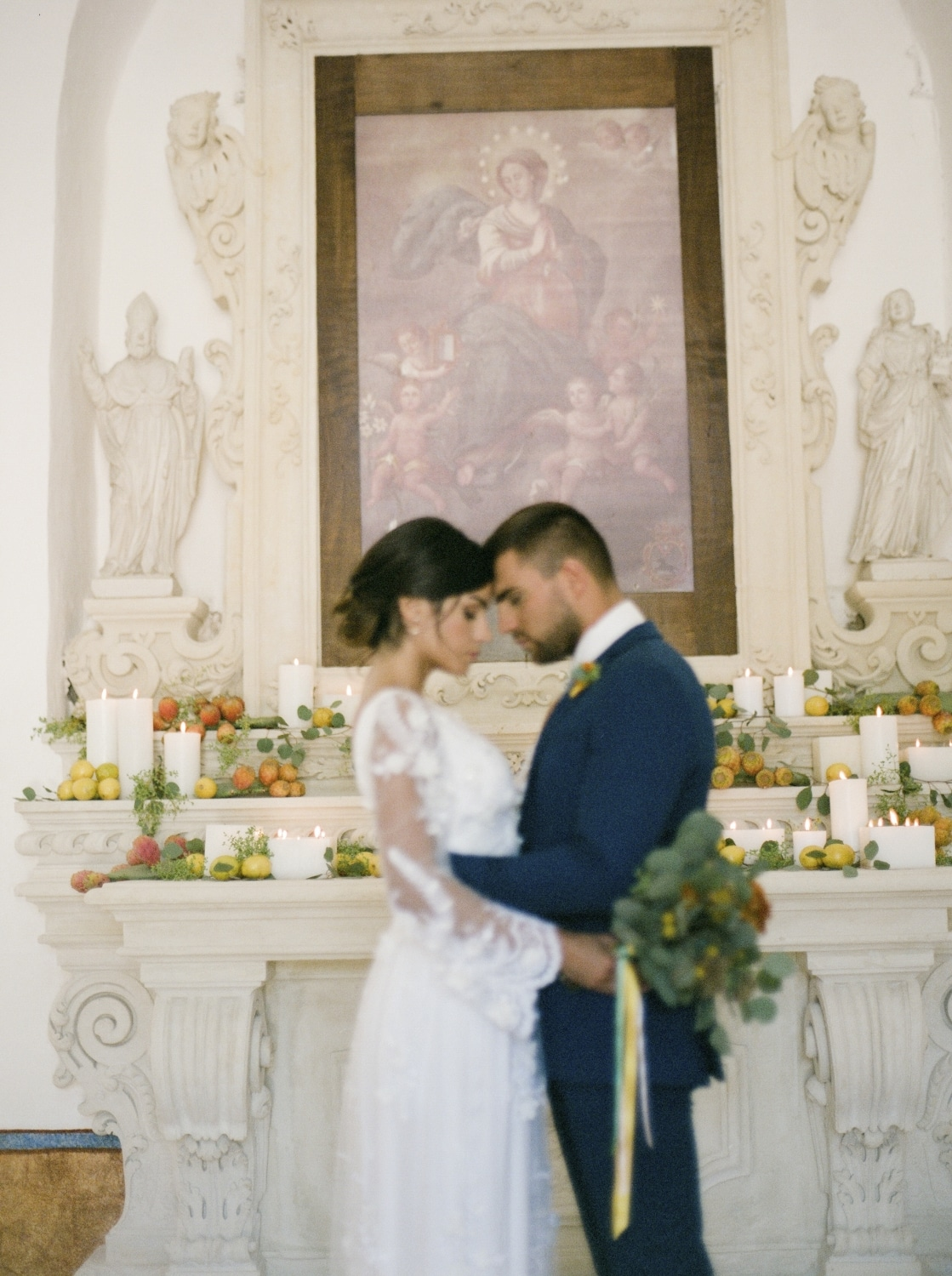 bride and groom holding each other in front of altar in Italian wedding