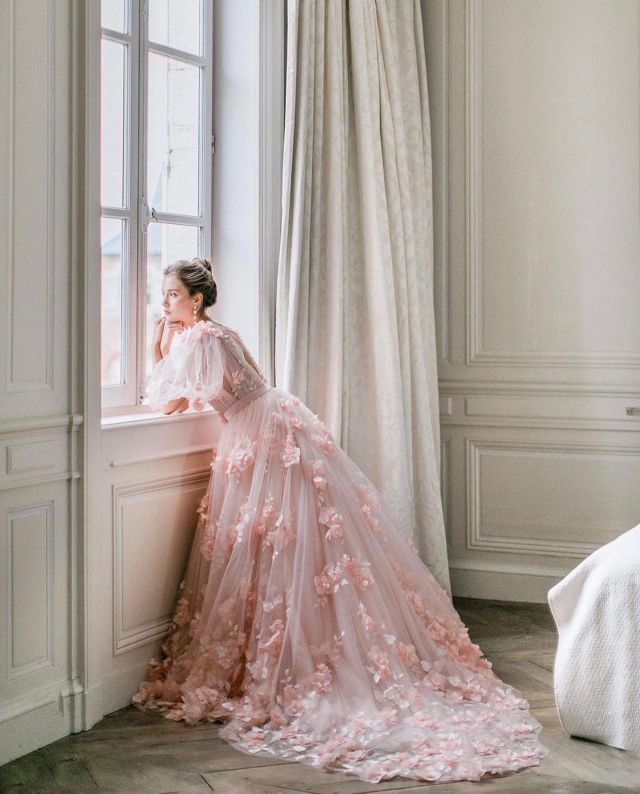 Oh don't mind us, we'll just be swooning over this pink floral applique wedding gown for the foreseeable future...⁠ ⁠ Venue @chateaudevarennes⁠ Planning & Coordination @hedherawedding ⁠ Artistic Direction @lmd.conseils ⁠ Floral Designer @lamaisondautel ⁠ Photographer  @geraldineleblanc.photography ⁠ Dresses @mademoisellerevemariage ⁠ MUAH  @mua_reinakim ⁠ Stationary  @bonjourpaper ⁠ Love letter  @zoezephyyr ⁠ Cake designer @weddingcakesandco ⁠ Boudoir  @atelier_1904 ⁠ Shoes @bellabelleshoes⁠ Accessories  @lindsaymariedesign⁠ Filmlab @carmencitalab⁠ ⁠  #frenchchateauwedding #chateaubride #frenchweddinggown #pinkweddinggown #romanticweddinggown #weddinggowninspiration #weddinggownideas #pinkweddingdress ( #📷 via @adore.blogmariage )⁠ #luxewedding #luxurywedding #luxuryweddings⁠ #pinkwedding #pinkweddinginspo #pinkweddinginspiration #pinkweddingideas